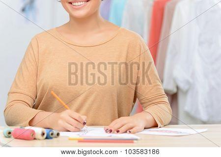 Pleasant designer making drawing
