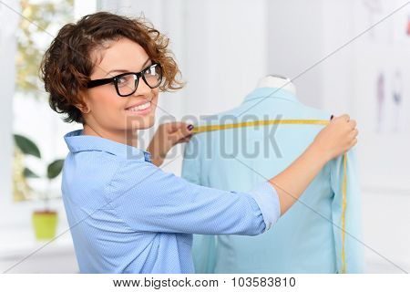 Pleasant designer making clothes