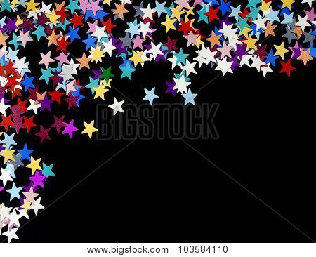 Starry Night Background; Coloured Stars Scattered On A Plain Black Background, Copy Space