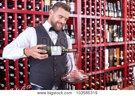 Attractive young waiter is working in liquor store