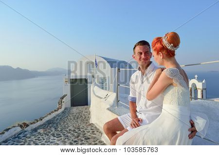 Beautiful young couple bride and groom celebrate wedding on Santorini