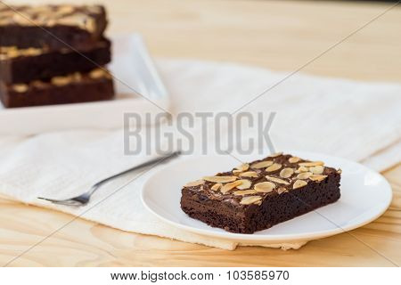 Pieces Of Chocolate Brownie Cake On A Wooden Background