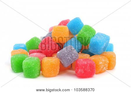 some cubic gumdrops of different colors on a white background