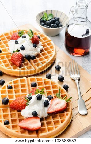 Blueberry waffles for breakfast with maple syrup