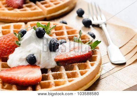 Breakfast - waffles with fresh berries and cream