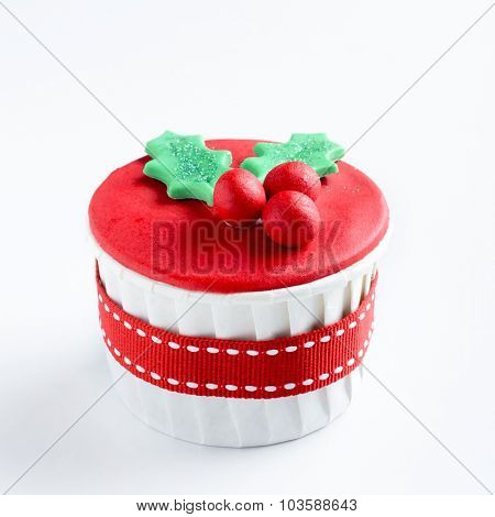 Christmas cupcake in traditional red green colors with mistletoe, decorative element