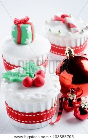 Christmas holiday festive cupcake with decoration bauble and ribbon