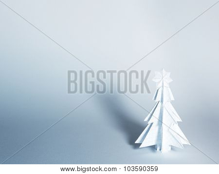 Christmas trees made of paper on white background. Christmas card.