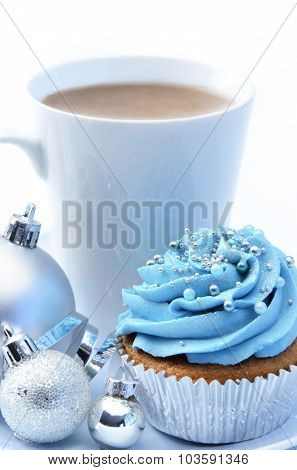 Christmas treat mug of hot chocolate, frosty icy blue theme cupcake with silver xmas bauble decorations