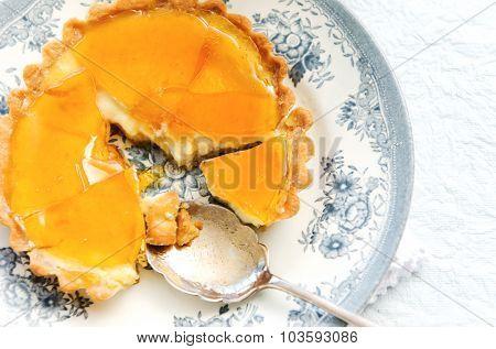 Vanilla custard tart with a beautiful caramelised surface served on a blue vintage plate