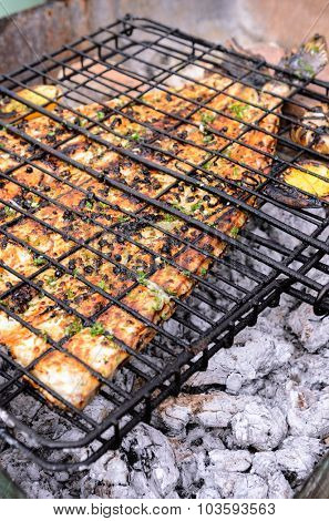 Grilling fish over charcoal, seafood barbecue barbeque bbq