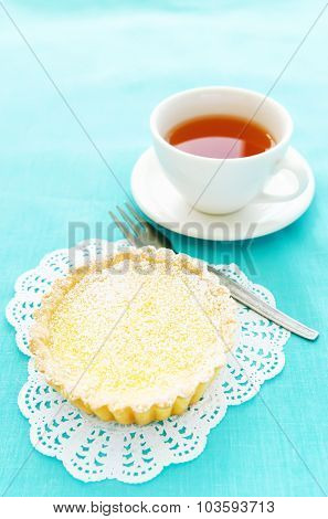 Appetizing dessert of lemon tart and a cup of tea