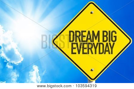 Dream Big Everyday sign with sky background