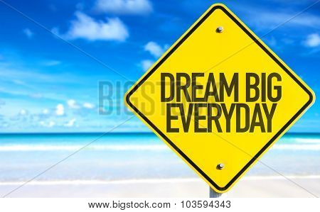 Dream Big Everyday sign with beach background
