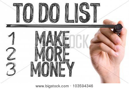 Hand with marker writing: To Do List: Make More Money