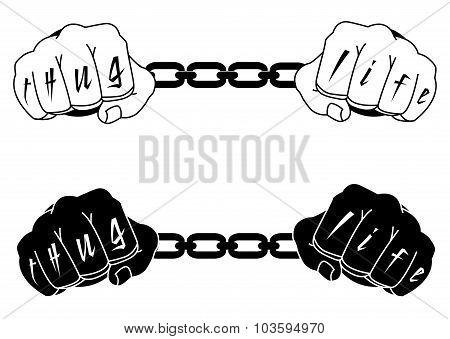 Male hands in steel handcuffs with Thug Life tattoo. Black, whit