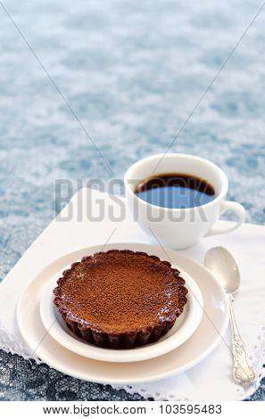 Cup of coffee served with a delicious and decadent chocolate pie