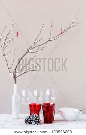 Modern minimalist christmas table setting decoration with pine cone and bare branch, simple neutral and rustic