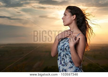 girl portrait at sunset on plain background