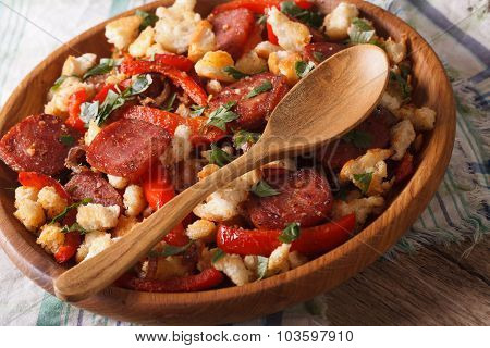 Spanish Migas With Chorizo, Bread Crumbs And Vegetables Close-up