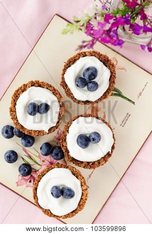 Blueberry tarts with muesli shells and yoghurt based filling, a healthy dessert treat alternative