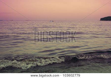 fishermen in the sea at sunset
