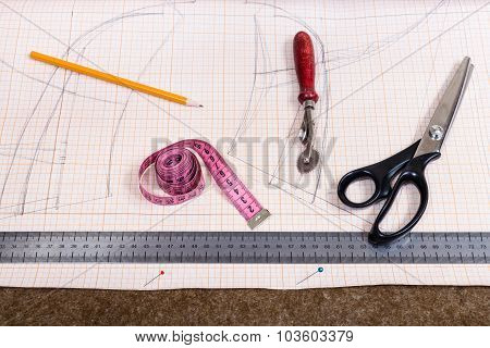 Tissue, Pen, Pattern, Tailor Tool On Cutting Table