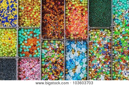 Multicolored Beads In A Plastic Box