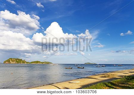 Small Fising Boat With White Cloud