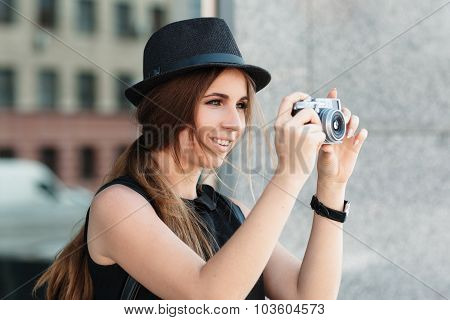 Smiling Student Photographs With Digital Camera.