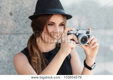 The Smiling Girl Photographs With Digital Camera.