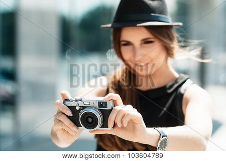 Casual Student Photographs With Digital Camera.