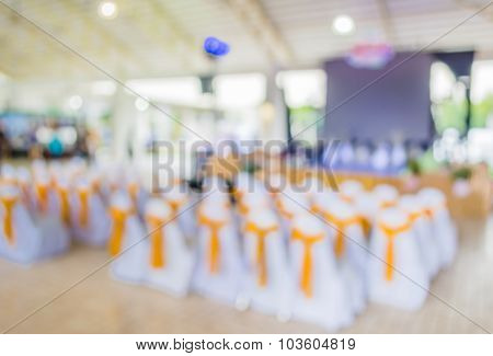 Blurred Image Of People In Auditorium With Open Space