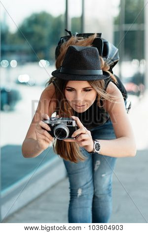 Tourist Photographs With Mirrorless Digital Camera.