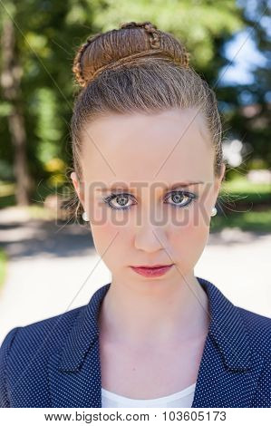 Portrait Of Young Businesswoman Outside In Park