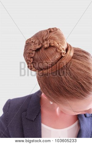 Business Woman With Intricate Bun Hairstyle