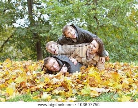 happy family relaxing in autumn park