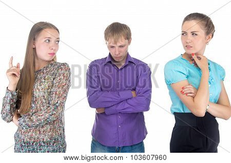 Puzzled Young Man And Two Blond Women