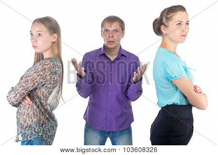 Confused Blond Man And Two Women