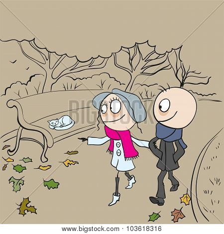 Loving couple walking in autumn park. Boy and girl walking in autumn park