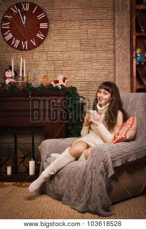 Young Girl Sitting By The Fireplace