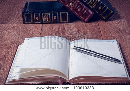 Notepad And Pen On Wooden Table