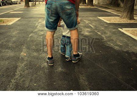 White Man Holding His Walking Son