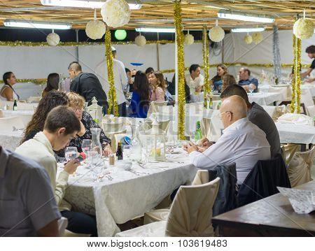 People Having Dinner In The Sukkah