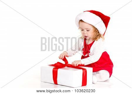 Beautiful little baby celebrates Christmas.