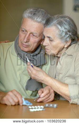 Ill senior couple with pills