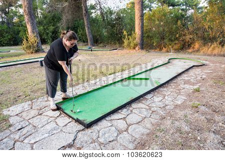Woman Playing Miniature Golf In The North Of Israel