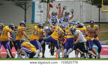 VIENNA, AUSTRIA - JULY 13, 2014: K Christopher Kappel (#2 Vikings) kicks a PAT during an Austrian football league game.