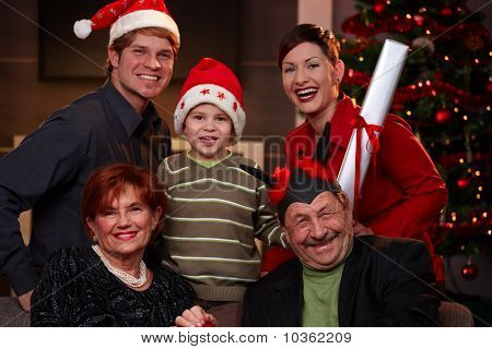 Happy Family At Christmas Eve