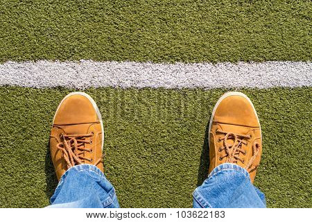 Male Sneakers On The Artificial Grass